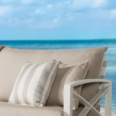 Plush, layered cushions allow moisture to drain, and are wrapped in Sunsharp® fabric.