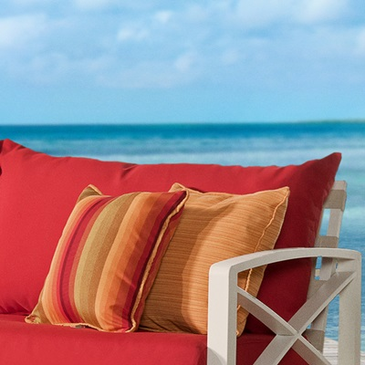 Plush, layered cushions allow moisture to drain, and are wrapped in Sunbrella® fabric.