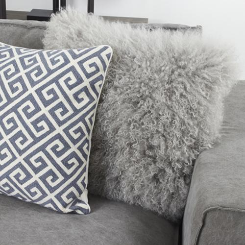 Large ultra soft Mongolian fur throw pillows with silver tones and blue/grey contrast.